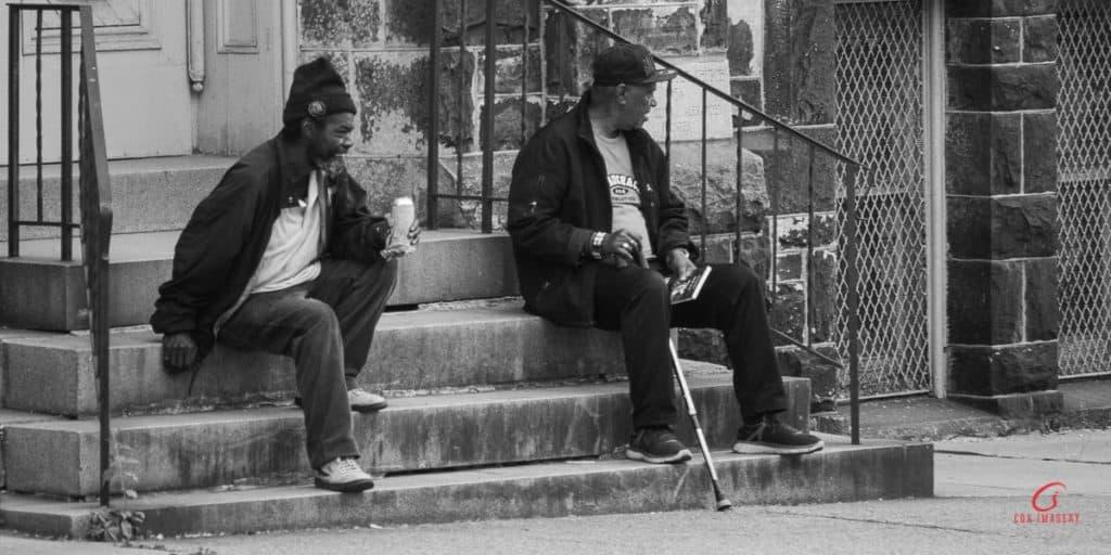 men on church steps